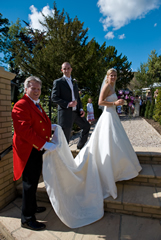 Essex toastmaster assisting the bride with her wedding dress