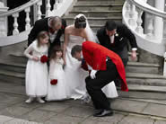 Toastmaster at Essex Wedding picking up bridesmaid's posy